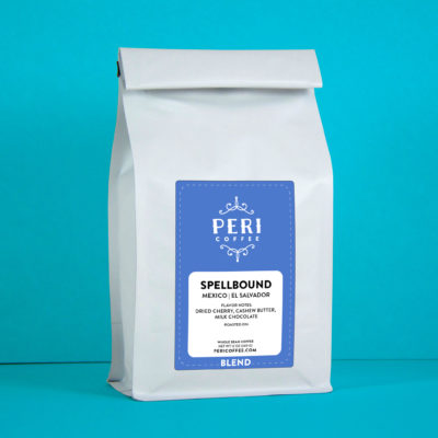 Photo of a bag of coffee with a blue label against an aqua colored background.