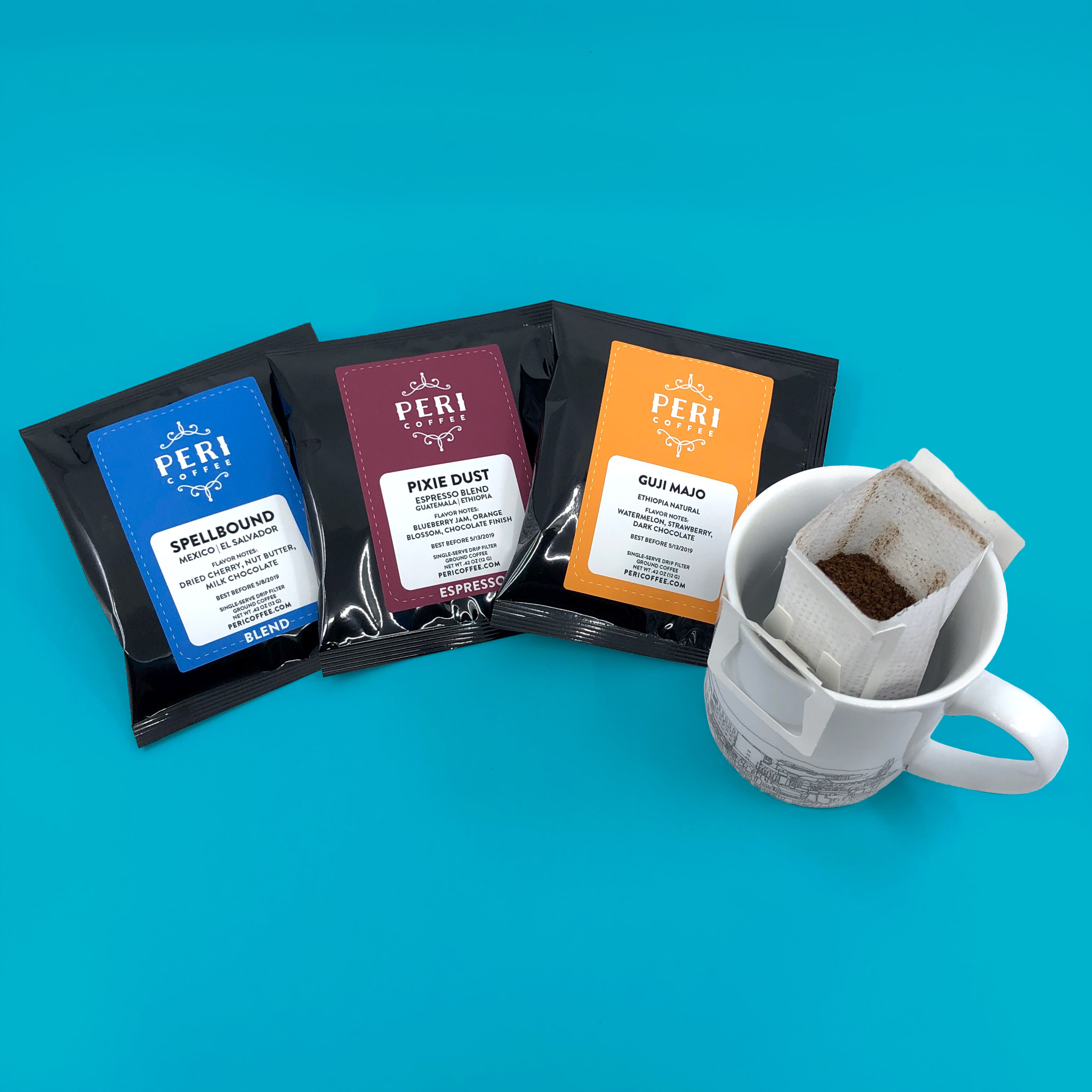 Single serve coffee pourover filters seasonal assortment with open filter over a mug