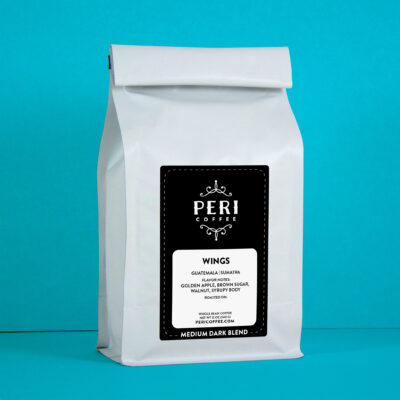 Package photo of Peri Coffee Medium Dark Roast blend. White coffee bag with black label.