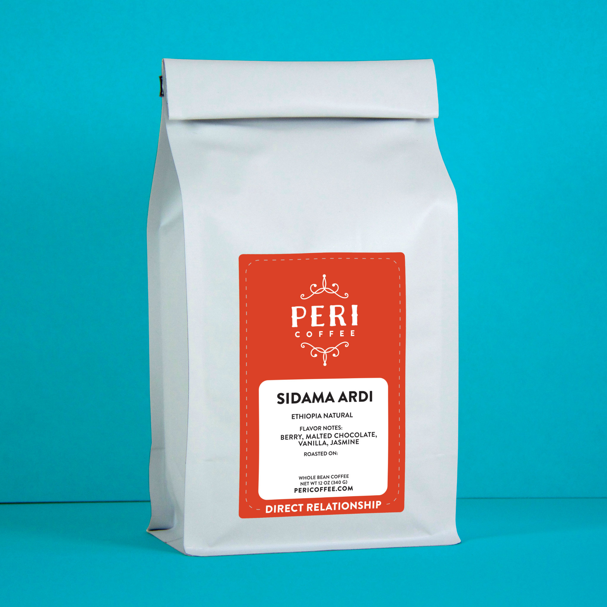 A white 12 ounce coffee bag with bright red label. Peri coffee Ethiopia Ardi Natural. Against turquoise background.